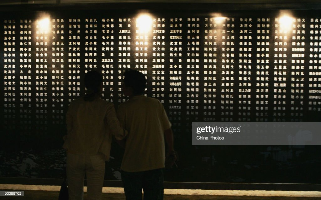 Visitors view a list of Chinese soldiers names who died during the