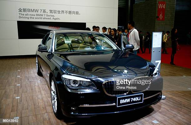Visitors view a sedan of BMW 740Li at the Auto Shanghai 2009 , at Shanghai New International Expo Center on April 20, 2009 in Shanghai, China. More...