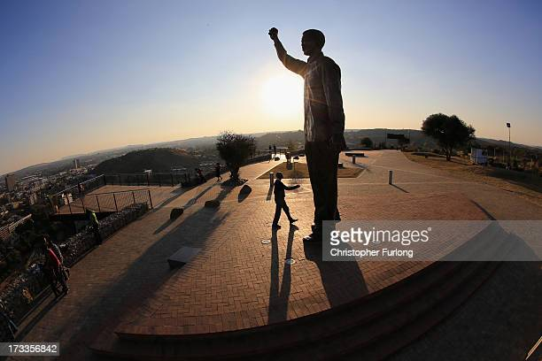 Visitors view a statue of Nelson Mandela which overlooks the city of Bloemfontein the birthplace of the ANC on July 12 2013 in Bloemfontein South...