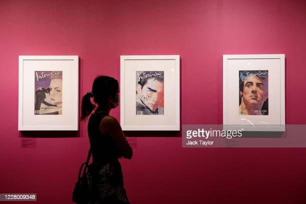 Visitors view Andy Warhol's Interview Magazine Covers from the 1980s featuring various celebrities at the 'Andy Warhol Pop Art' exhibition at the RCB...