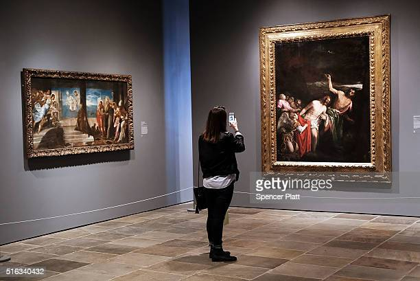 Visitors view artwork on the opening day of the new museum The Met Breuer an expansion of the Metropolitan Museum of Art on March 18 2016 in New York...
