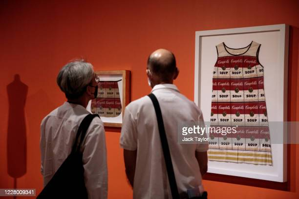 Visitors view 'Campbell's Soup Dress' by Andy Warhol at the 'Andy Warhol Pop Art' exhibition at the RCB Galleria on August 12 2020 in Bangkok...