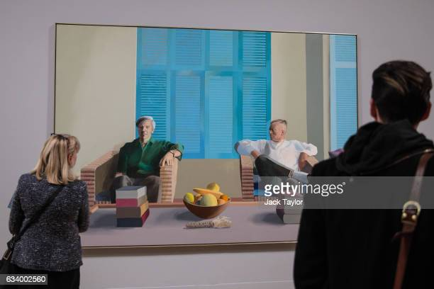 Visitors view 'Christopher Isherwood and Don Bachardy' 1968 by David Hockney during a press preview for the British artists' retrospective at Tate...