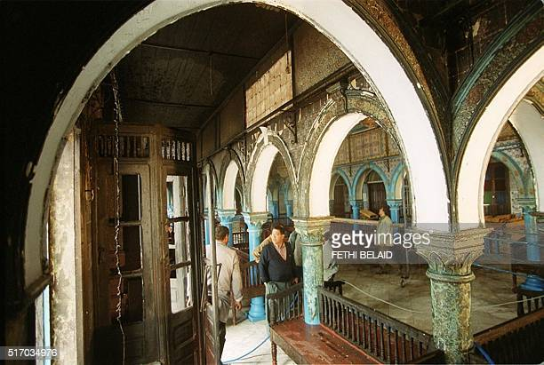 Visitors view damages inside the Djerba synagogue South Western Tunisiataken 12 April 2002 after a fuel tanker crashed outside the building 11 April...