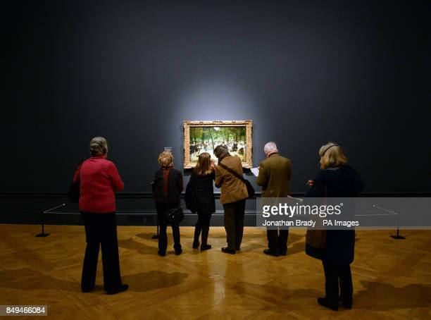 Visitors view Edouard Manet's 'Music in the Tuileries Gardens' during a press view of 'ManetPortraying Life' the first major exhibition in the UK to...