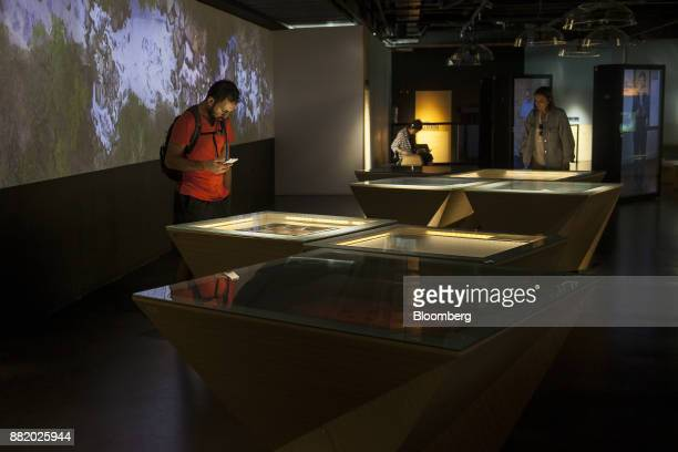 Visitors view information on victims of Colombia's armed conflict at the Museo Casa de la Memoria in Medellin Colombia on Tuesday Oct 3 2017 In...
