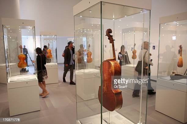 Visitors view instruments made by Antonio Stradivari on display in the exhibition 'Stradivarius' at the Ashmolean museum on June 12 2013 in Oxford...