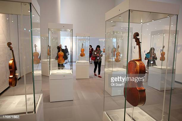 Visitors view instruments made by Antonio Stradivari on show at the exhibition 'Stradivarius' at the Ashmolean museum on June 12 2013 in Oxford...