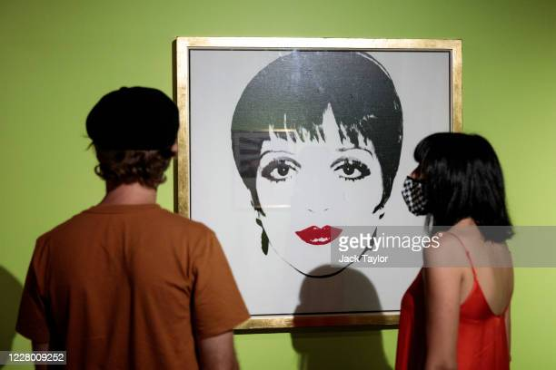 Visitors view 'Liza Minelli' by Andy Warhol at the 'Andy Warhol Pop Art' exhibition at the RCB Galleria on August 12 2020 in Bangkok Thailand The...