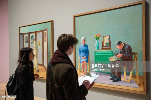 Visitors view 'My Parents' 1977 by David Hockney during a press preview for the British artist's retrospective at Tate Britain on February 6 2017 in...