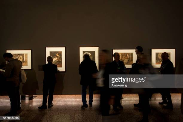 Visitors view paintings by Van Gogh inside at 'Van Gogh between the wheat and the sky' exhibition during the press preview on October 4 2017 in...