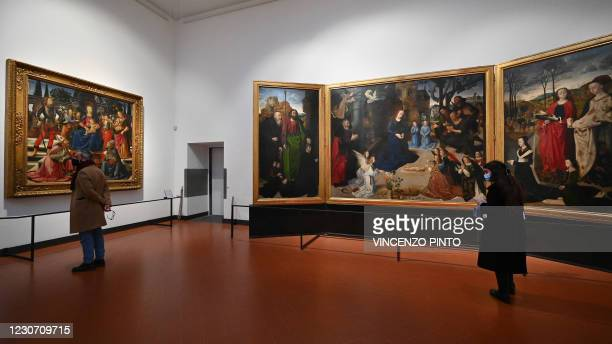 Visitors view paintings on January 21, 2021 on the reopening of the Uffizi Galleries in Florence, Tuscany. - The Uffizi Galleries in Florence, a...