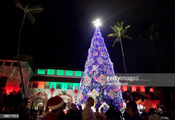 Visitors view the annual Honolulu City Lights a holiday season tradition at the Honolulu City Hall grounds on December 18 2011 in Honolulu Hawaii