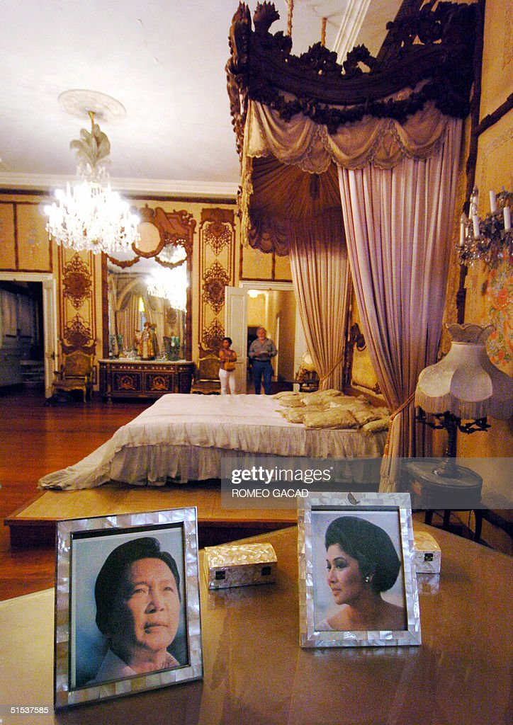 Visitors view the bedroom of Imelda Marcos at the Santo Nino shrine 13 October 2004 that was sequestered by the government. When the former first lady built the mansion in 1981 in her hometown Tacloban, it was dubbed by many as the Malacanang presidential palace of the south. The mansion named after religious icon of the Child Jesus stands as a monument to the obscene excesses of the Marcos years whenthe late dictator Ferdinand Marcos was deposed by military-backed people power revolt in 1986 after 20 years in power.