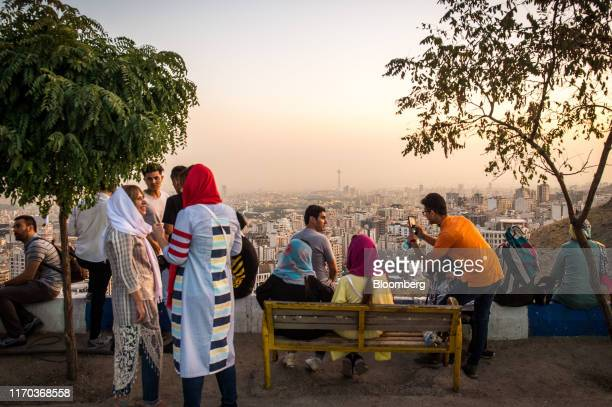 Visitors view the city skyline from a terrace at the Bame Tehran stone wall in Tehran Iran on Friday Sept 20 2019 Iranian Foreign MinisterMohammad...