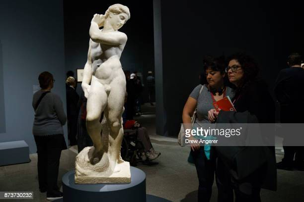 Visitors view the marble sculpture ApolloDavid at the new Michelangelo exhibit titled 'Michelangelo Divine Draftsman and Designer' at the...