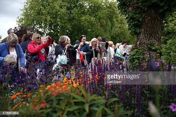 Visitors view the Morgan Stanley Healthy Cities show garden on the first public day of the Chelsea Flower Show on May 19 2015 in London England The...
