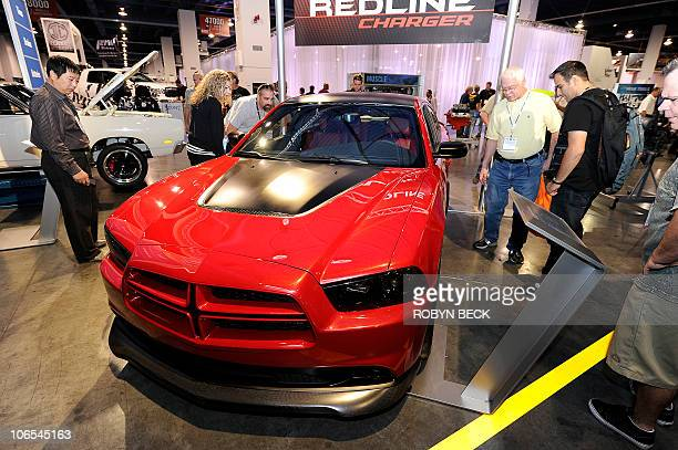 Visitors view the new 2011 Dodge Charger R/T Redline at the 2010 Specialty Equipment Market Association trade show in Las Vegas Nevada November 4...