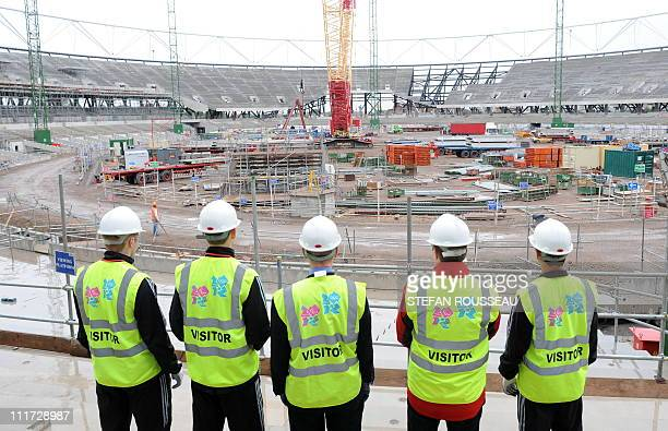 Visitors view the ongoing construction work at the 2012 Olympic stadium in east London, on July 27, 2009. The countdown starts today to the opening...