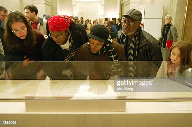 Visitors view the original Emancipation Proclamation during a one day only exhibit January 19 2003 at the National Archives in Washington DC The...