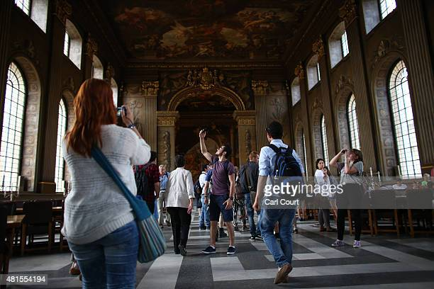 Visitors view the Painted Hall in the Old Royal Naval College on July 22 2015 in Greenwich England The Old Royal Naval College World Heritage Site...