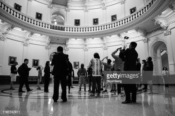 Image has been converted to black and white.) Visitors view the rotunda at the Texas State Capitol in Austin, Texas, U.S., on Thursday, April 18,...