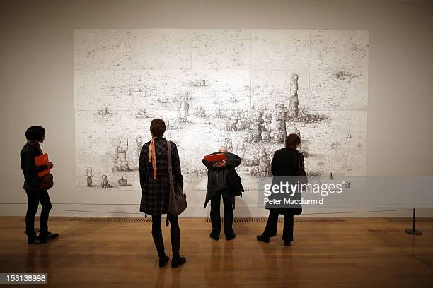 Visitors view Turner Prize nominee Paul Noble's 'Villa Joe 20056' on display at Tate Britain on October 1 2012 in London England The GBP£25000 Turner...