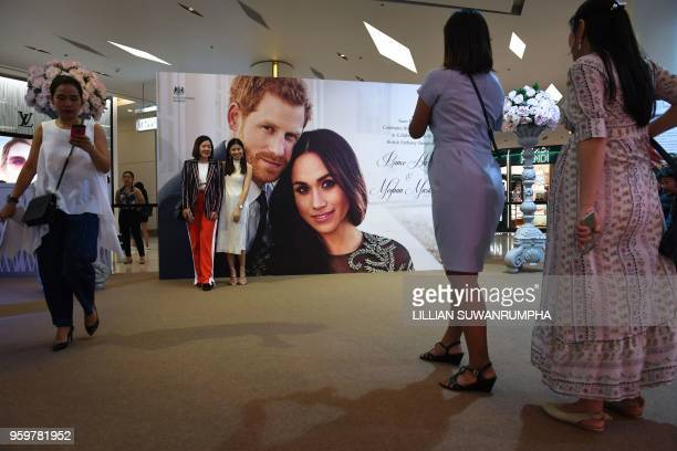 Visitors view various displays during the launch of an exhibition commemorating the royal wedding of Britain's Prince Harry and US actress Meghan...