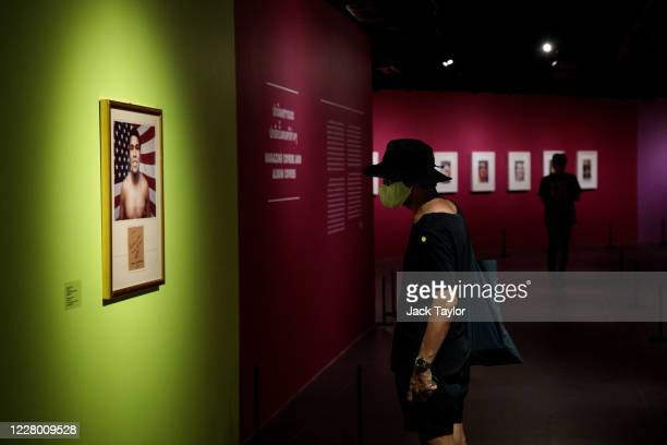 Visitors view works by Andy Warhol at the 'Andy Warhol Pop Art' exhibition at the RCB Galleria on August 12 2020 in Bangkok Thailand The exhibition...