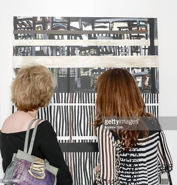 Visitors viewing artwork by Alberto Baccari at Clen Gallery Art Exhibition at Rogue Space on October 17 2013 in New York City