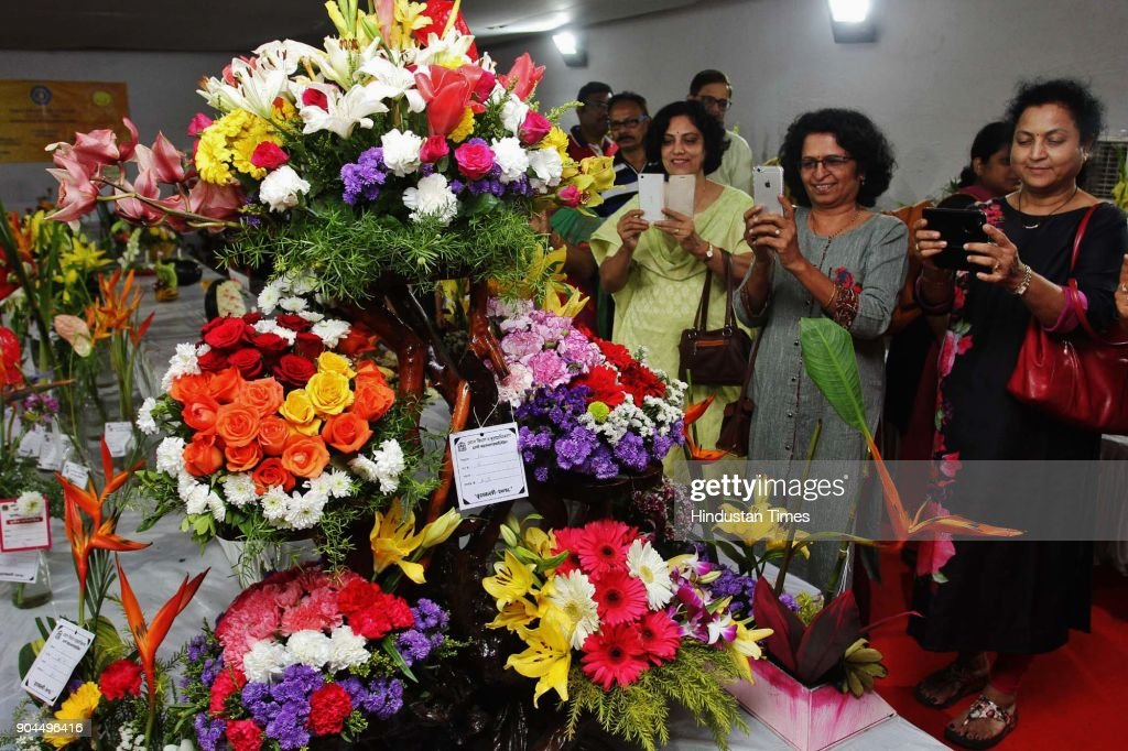 Visitors visit during the flower exhibition at Raymond ground, Vartak Nager, on January 12, 2018 in Mumbai, India.