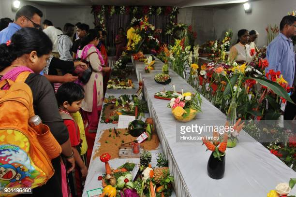 Visitors visit during the flower exhibition at Raymond ground Vartak Nager on January 12 2018 in Mumbai India