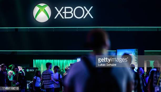 Visitors visit the booth of XBOX during the press day at the 2019 Gamescom gaming trade fair on August 20, 2019 in Cologne, Germany. Gamescom 2019,...