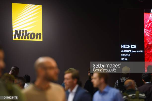 Visitors visit the Nikon stand at the Photokina trade fair in Cologne, western Germany on September 27, 2018. - The fair for the photographic and...