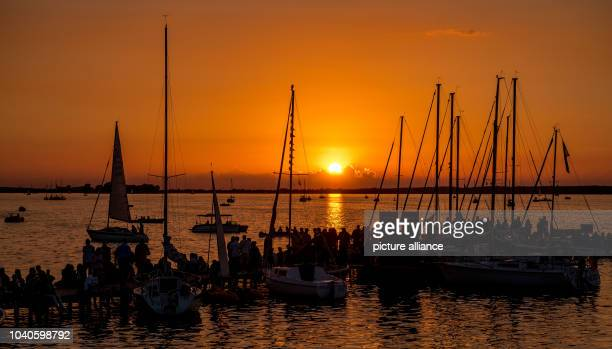 Visitors wait for the beginning of the traditional fireworks display during the weekend-long festival 'Steinhuder Meer in Flammen' in Steinhude,...