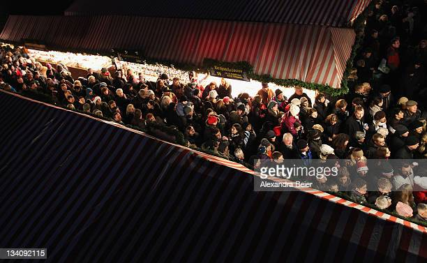 Visitors wait for the opening ceremony of the famous Christmas market 'Nuernberger Christkindlesmarkt' on November 25 2011 in Nuremberg Germany