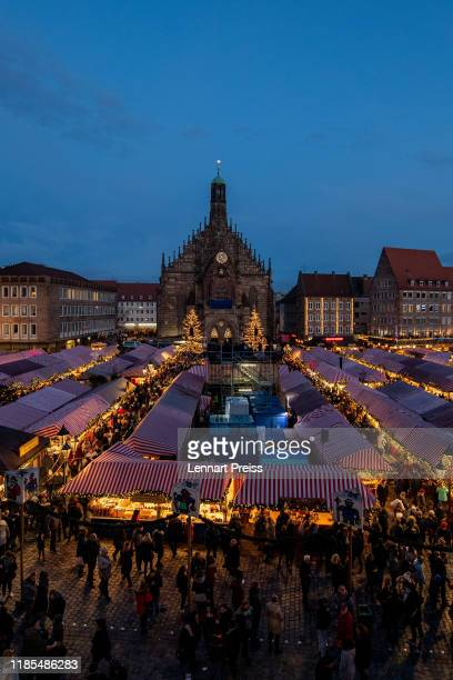 Visitors wait for the opening of the Nuremberg Christmas Market on November 29, 2019 in Nuremberg, Germany. The Nuremberg Christmas Market will be...