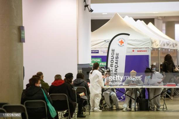 Visitors wait for their Covid-19 vaccines at the Stade de France vaccination center in Paris, France, on Tuesday, April 13, 2021. The French economy...