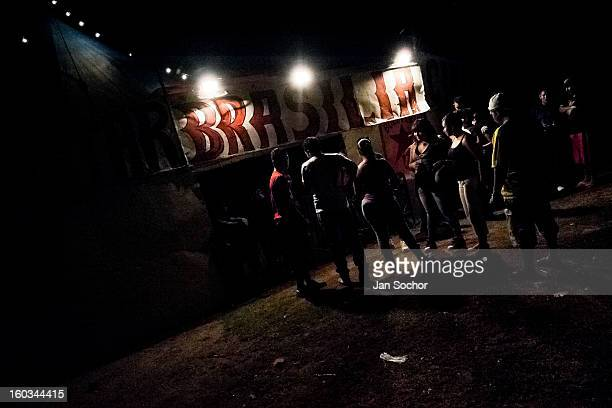 Visitors wait in front of the ticket office of the Circo Brasilia on May 10 2011 in Apopa El Salvador The Circo Brasilia belongs to the oldfashioned...