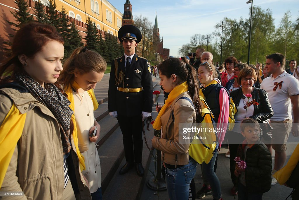Visitors wait in line to place flowers at the Tomb of the Unknown Soldier near Red Square ahead of celebrations to mark the 70th anniversary of the victory over Nazi Germany and the end of World War II on May 7, 2015 in Moscow, Russia. The city of Moscow will celebrate the anniversary on May 9 with a Victory Day international military parade and other events that most European leaders are snubbing because they accuse Russia of involvement in the war in eastern Ukraine.