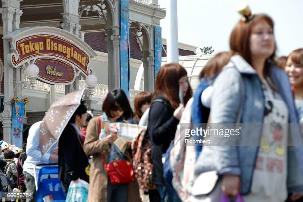 Visitors wait in line to take photographs with the Walt Disney Co character Mickey Mouse not seen at Tokyo Disneyland operated by Oriental Land Co in...