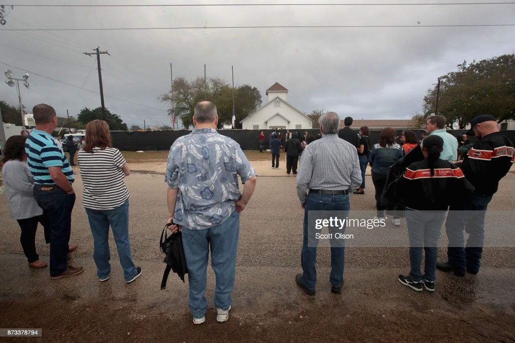 Visitors wait in line to tour the First Baptist Church of Sutherland Springs after it was turned into a memorial to honor those who died on November 12, 2017 in Sutherland Springs, Texas. The inside of the church has been painted white with 26 white chairs placed around the room. On each chair is a single rose and the name of a shooting victim. The chairs are placed throughout the room at the location where the victim died. Devin Patrick Kelley shot and killed the 26 people and wounded 20 others when he opened fire during Sunday service at the church on November 5th.