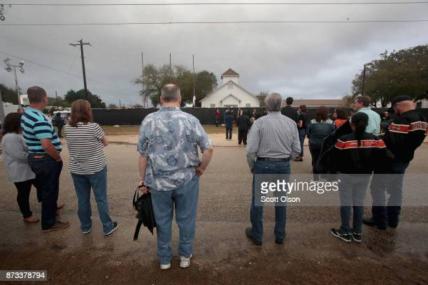 Visitors wait in line to tour the First Baptist Church of Sutherland Springs after it was turned into a memorial to honor those who died on November...