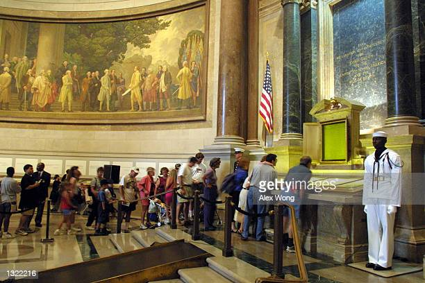 Visitors wait in line to view the original copies of the Declaration of Independence the Constitution and the Bill of Rights July 4 2001 at the...