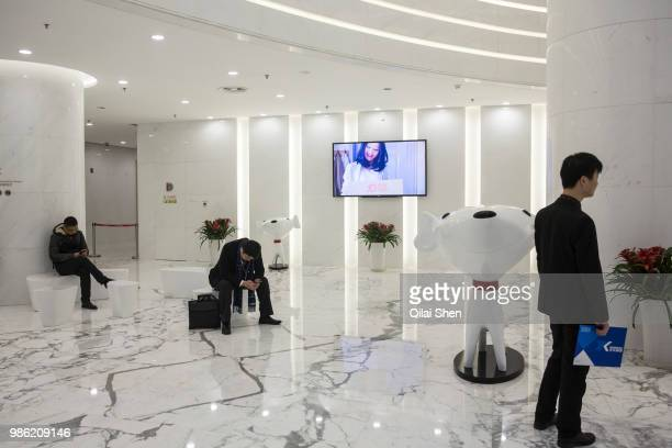 Visitors wait in the front lobby of JDcom's headquarters in Beijing China on Monday Nov 30 2015 JDcom is China's second largest online retailer and...