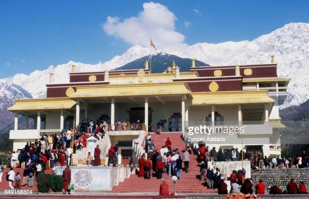 Visitors wait outside the Gyuto Monastery for the 17th Karmapa Lama to greet them near Dharamsala Himachal Pradesh India on Feb 7 2000 After weeks...