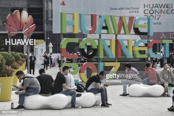 Visitors wait to enter the Huawei Connect 2017 conference in Shanghai China on Tuesday Sept 5 2017 Huawei Technologies Co aims to establish a union...