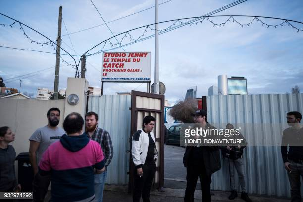 Visitors wait to watch a wrestling show on March 11 in Nanterre, near Paris. - In Nanterre, the French Association of Professional Wrestling revives...
