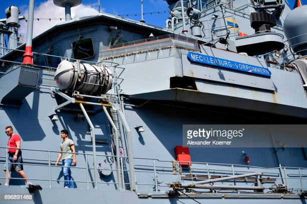 Visitors walk aboard the frigate 'Mecklenburg Vorpommern' of the German Navy during an open day of the barracks at the Kieler Woche on June 17 2017...