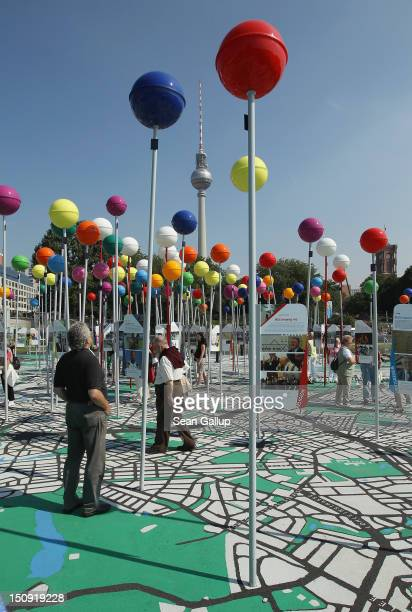 Visitors walk across a giant map of Berlin in 1775th scale complete with giant coloured pins marking sites of historical significance as the...